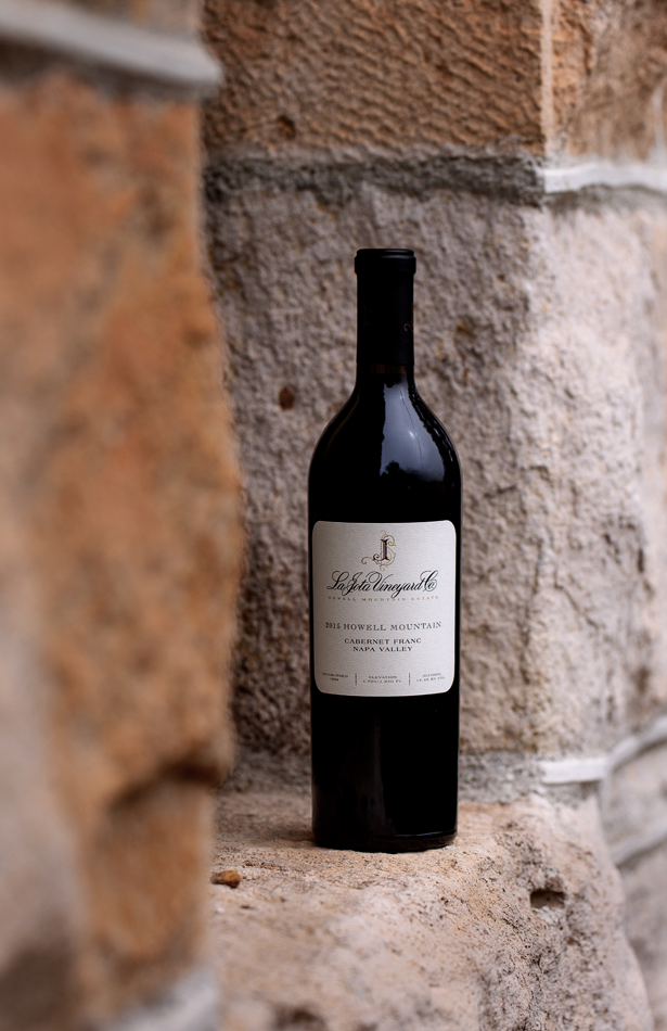 La Jota Cabernet Franc Bottle Shot on a stone wall